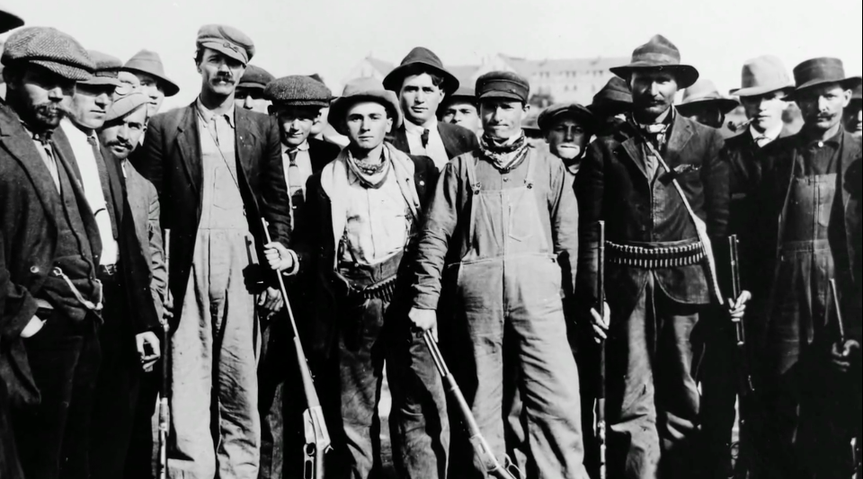 Armed miners participating in the 1914 Ludlow strike Photo Survey Associates Inc. II